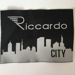 Этикетка жаккардовая вышитая Riccardo 55мм заказная (1000 штук)
