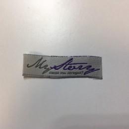 Этикетка жаккардовая вышитая Mystery 10 мм заказная (1000 штук)