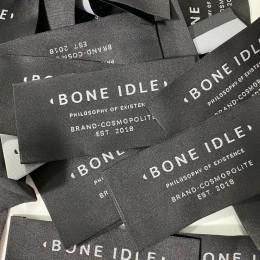 Этикетка жаккардовая вышитая Bone idle 50мм заказная (1000 штук)